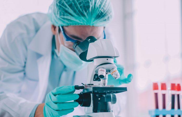 Doctor research vaccine corona virus,Doctor analyzing microscope in lab hospital